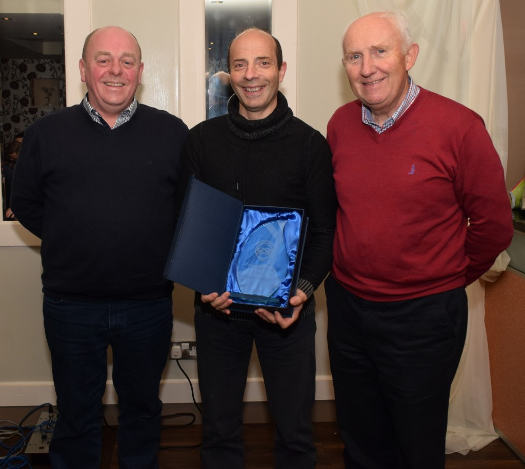 Club Secretary Paul Lonergan with Declan Hanrahan, Senior sorts star of the year, with Billy Kennedy, club vice president, Olympic council of Ireland .