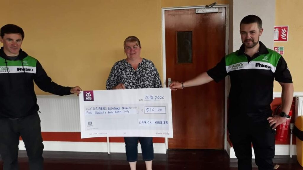Hugh Mulhearne and Tom O'Connell Presenting the Cheque